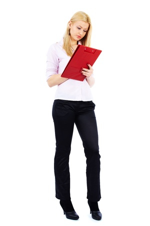 Full length portrait of a young businesswoman writing on a clipboard photo