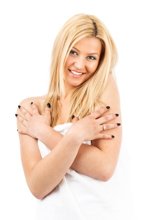 body care: Beautiful young blond woman wrapped in spa towel, isolated on white