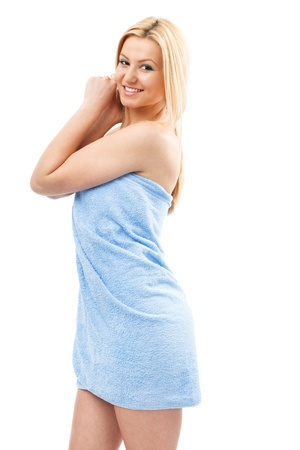 wrapped in a towel: Beautiful young blond woman wrapped in spa towel, isolated on white