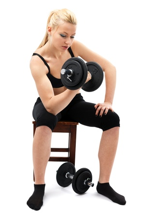 Athletic young woman doing workout with weights Stock Photo - 13120814