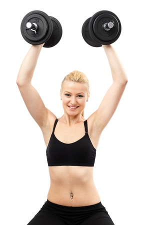 Athletic young woman doing workout with weights Stock Photo - 13120819