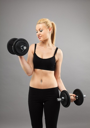 Athletic young woman doing workout with weights photo