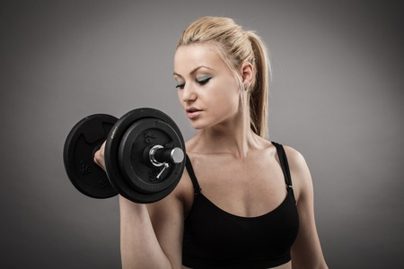 lift hands: Athletic young woman doing workout with weights Stock Photo