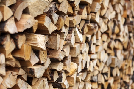 Stacked chopped wood for the winter or construction Stock Photo - 13220418