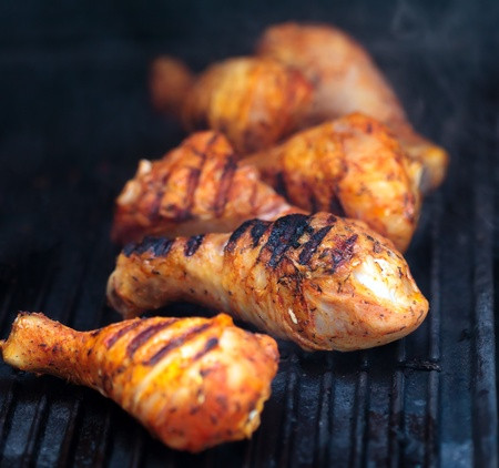 bbq chicken: Closeup of a barbecue grill with drumstick Stock Photo