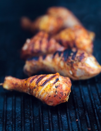 chicken leg: Closeup of a barbecue grill with drumstick Stock Photo