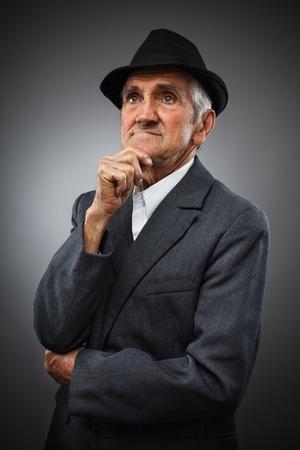 suspicious man: Studio portrait of an expressive old man