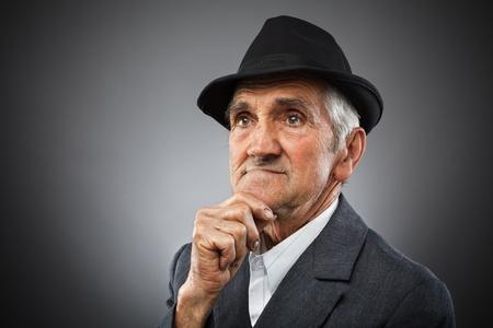 skinny: Studio portrait of an expressive old man