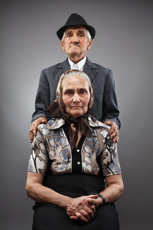 Portrait of an elderly couple in studio photo