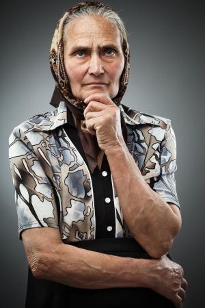 wrinkled: Elderly woman with kerchief, studio portrait