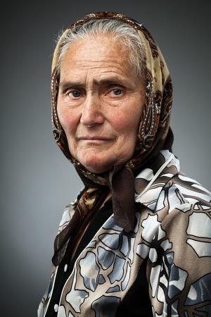 Elderly woman with kerchief, studio portrait photo