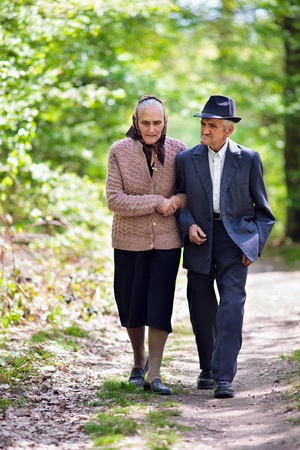 Senior couple walking outdoor in the park photo