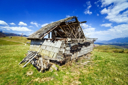ruinous: Landscape with an abandoned wooden shack Stock Photo