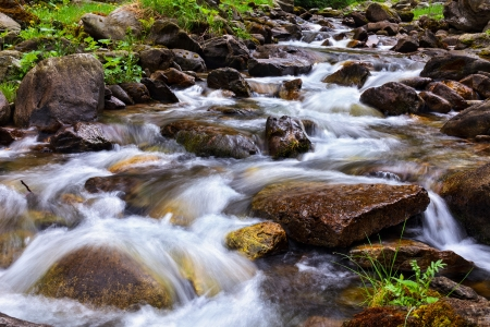 rapid: Landscape with river flowing through rocks Stock Photo