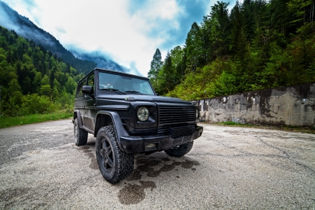 Rugged off-road car in the mountains Stock Photo - 13815150