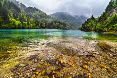 Landscape with a lake in the mountains in a rainy day Stock Photo - 13815078