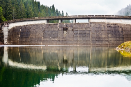 Landscape with a concrete dam in the mountains photo