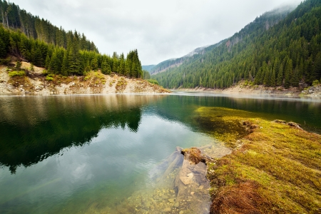 Landscape with lake Galbenu in Parang mountains in Romania photo