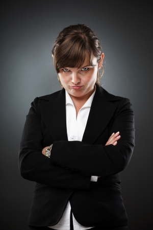 circumspect: Businesswoman with an expression of distrust, studio shot Stock Photo