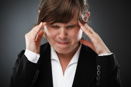 Young businesswoman with strong migraine Stock Photo - 15635131