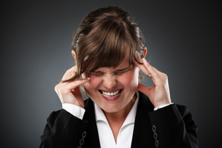 Young businesswoman with strong migraine photo