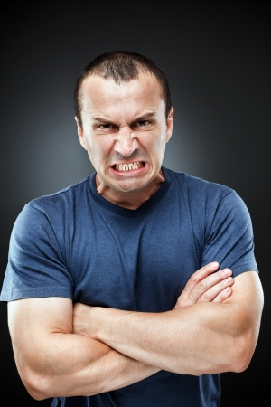Portrait of an extremely angry young man Stock Photo - 15609937