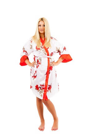 Young caucasian lady in bathrobe over white background Stock Photo - 15609948