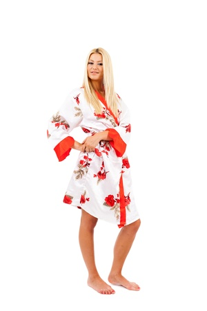 Young caucasian lady in bathrobe over white background Stock Photo - 15609970