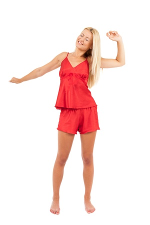 Young woman in red pajamas over white background photo