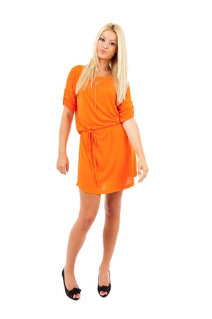Young blond woman in orange dress over white background Stock Photo - 15609946