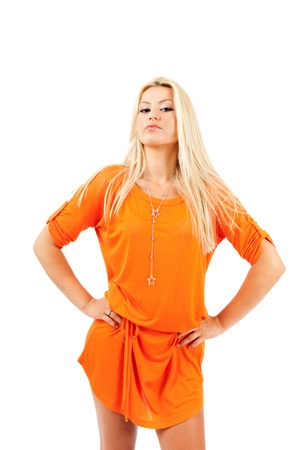 Young blond woman in orange dress over white background Stock Photo - 15609934