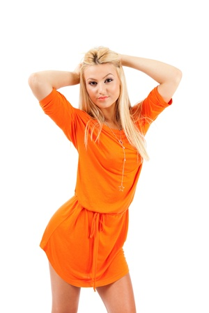 Young blond woman in orange dress over white background Stock Photo - 15609930