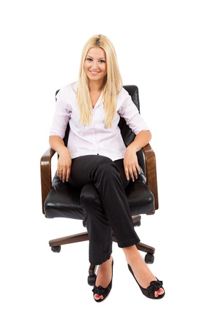 Young blond businesswoman in a chair isolated on white background Stock Photo - 15609962