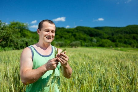 Young farmer outdoor in the wheat field photo