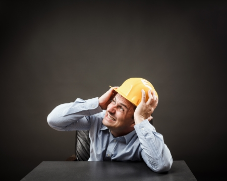 Engineer scared of something huge about to collapse on his head Stock Photo - 15662223