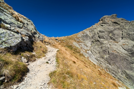 Landscape with mountain trail and clear blue sky photo