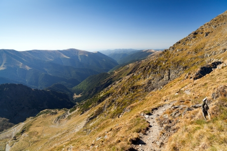 massif: Landscape with mountain trail and clear blue sky Stock Photo