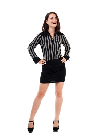 Full length portrait of a businesswoman standing with hands on hips photo
