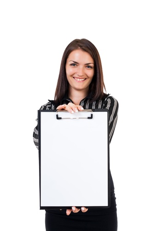 Portrait of a young businesswoman showing a blank clipboard photo
