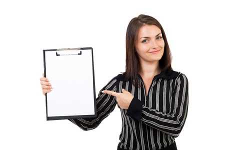 Portrait of a happy young businesswoman pointing at a clipboard, isolated on white background photo