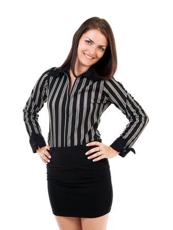 Portrait of a happy young businesswoman standing with hands on hips, isolated on white photo