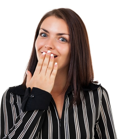 Portrait of a surprised young woman covering her mouth, isolated on white background photo