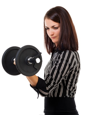 strong toughness: Portrait of a young successful businesswoman lifting dumbbell, isolated on white background Stock Photo