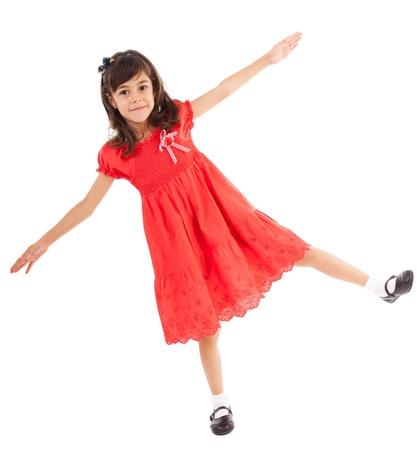 pretty feet: Full length portrait of a happy little girl playing, isolated on white background