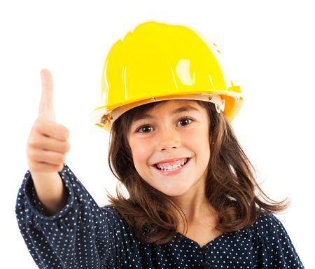 imitating: Closeup portrait of a little girl with yelow helmet showing thumbs up, isolated on white background