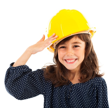 Closeup portrait of a little girl wearing yellow helmet salute