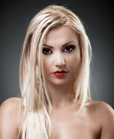Studio shot of a beautiful topless blond woman on gray background, closeup Stock Photo - 16324198