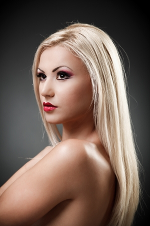 Studio shot of a beautiful topless blond woman on gray background, closeup Stock Photo - 16324244