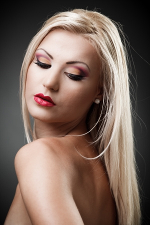 Studio shot of a beautiful topless blond woman on gray background, closeup Stock Photo - 16324267