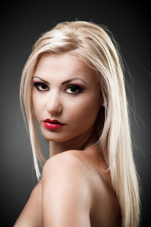 Studio shot of a beautiful topless blond woman on gray background, closeup Stock Photo - 16324256